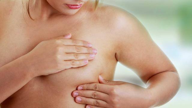 HG382_woman-selfexam-breast-cysts_FS